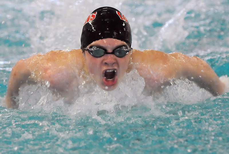 Loveland High School freshman Ethan McNally swims in the 100-yard butterfly during a dual meet against Rocky Mountain on Tuesday at the Mountain View Aquatic Center.