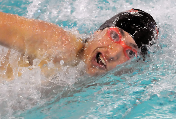 Loveland High School sophomore Travis Davis swims in the 100-yard freestyle during a dual meet against Rocky Mountain on Tuesday at the Mountain View Aquatic Center.