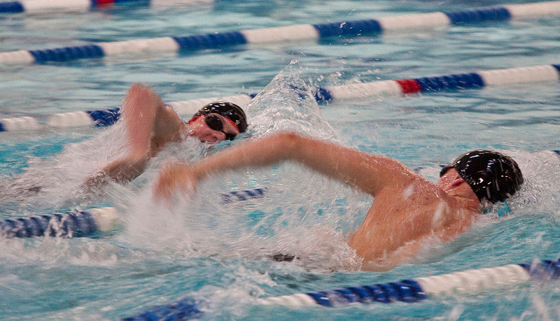 Loveland High School freshman Ethan McNally, left, swims in the Mens 200 Yard Freestyle preliminaries next to Arapahoe High School junior Silas Getz on Friday afternoon at the Edora Pool Ice Center at 1801 Riverside in Fort Collins. McNally finished first in the heat with a time of 1:47.55.