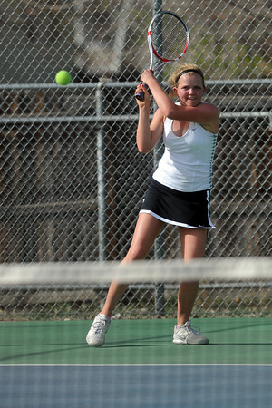 Loveland High School senior Jen Weissmann during her No. 1 singles match against Thompson Valley's Andrea Brush on Friday, March 30, 2012 at TVHS.