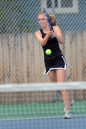 Loveland High School's Joelle Foster during her No. 3 singles match against Thompson Valley's Shannon Galligan on Friday, March 30, 2012 at TVHS.