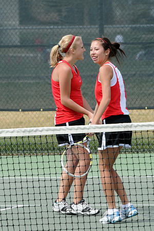 Loveland High School's Katie Nottberg, left, and Ashlyn Wong share a laugh during one of their No. 2 doubles matches for the Northern Colorado Invitational on Friday, April 13, 2012 at LHS.