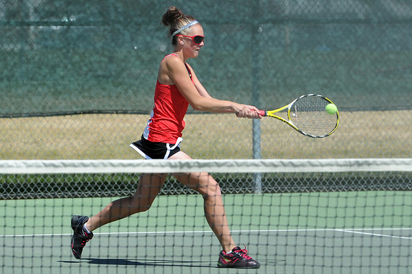 Loveland High School's Jordan Paulus returns a shot during a No. 2 singles match for the Northern Colorado Invitational on Friday, April 13, 2012 at LHS.