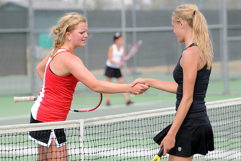 Loveland High School senior Jen Weissmann, left, shakes hands with Eaton's Kortney Lockey after defeating Lockey 6-0, 6-0 in the No. 1 singles finals of the Northern Colorado Invitational on Friday, April 13, 2012 at LHS.