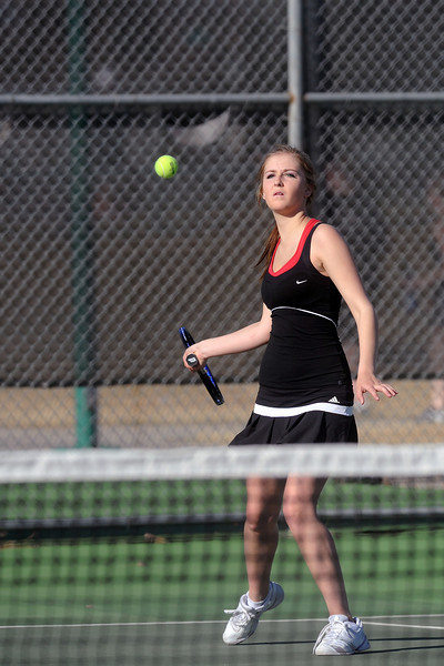 Loveland High School's Maddie Winn-Clouse returns a shot during her No. 3 singles match against Mountain View's Kelci Mueller on Thursday, March 15, 2012 at LHS.