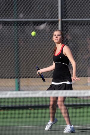 Loveland High School's Maddie Winn-Clouse returns a shot during her No. 3 singles match against Mountain View's Kelci Mueller on Thursday, March 15, 2012 at LHS.
