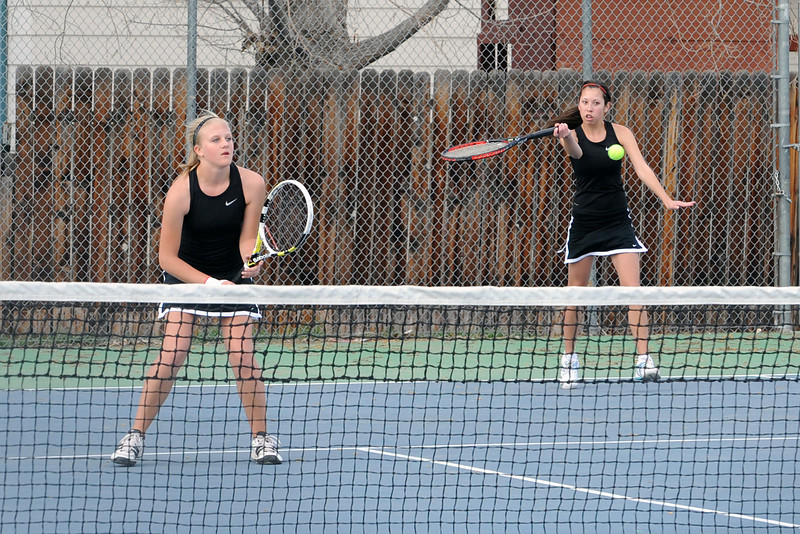 Loveland High School's Ashlyn Wong, right, returns a shot while her No. 2 doubles teammate Katie Nottberg plays at the net during their match against Thompson Valley's Kaley Hernblom and Kaitlyn Hill on Friday, March 30, 2012 at TVHS.