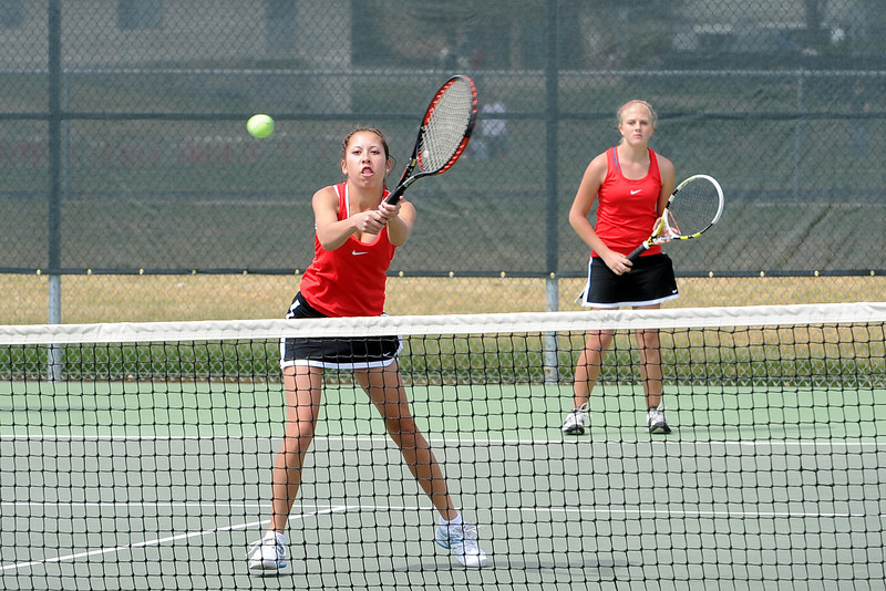 Loveland High School's Ashlyn Wong hits a volley at the net while her No. 2 doubles partner Katie Nottberg looks on during the Northern Colorado Invitational on Friday, April 13, 2012 at LHS.