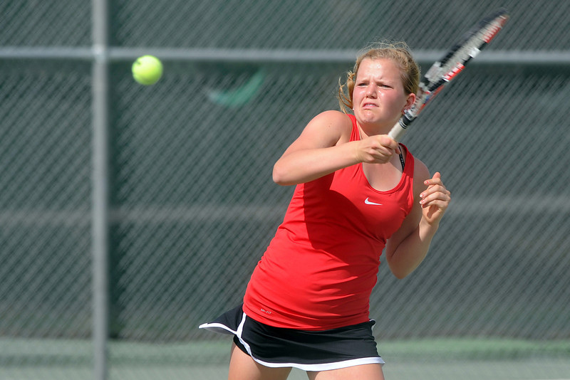 Loveland High School senior Jen Weissmann returns a shot during her match against Eaton's Kortney Lockey in the No. 1 singles finals of the Northern Colorado Invitational on Friday, April 13, 2012 at LHS.
