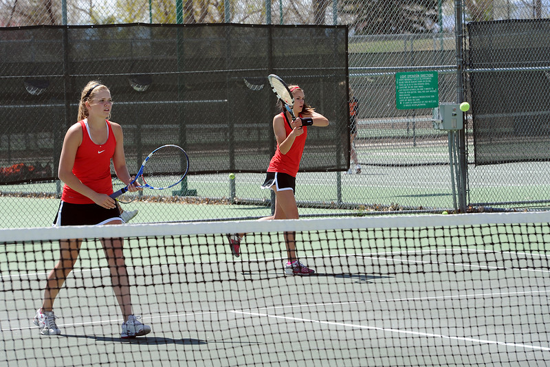 Loveland High School's Sarah Clinkenbeard, right, returns a shot while her No. 1 doubles partner Kim Weissmann plays at the net during their match against Fort Collins' Leah Fox and Katie Dugan for the Northern Colorado Invitational on Friday, April 13, 2012 at LHS.
