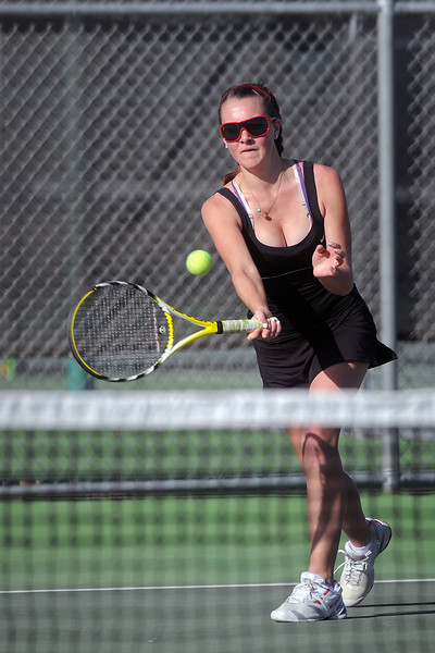 Loveland High School senior Jordan Paulus returns a shot during her No. 2 singles match against Mountain View's Danielle Sheffler on Thursday, March 15, 2012 at LHS. Paulus won the match 6-2, 6-2.