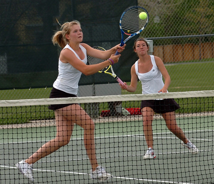 Loveland's #1 doubles team Kim Weissmann, left, and Kacey Helgenberg play during a match Friday.