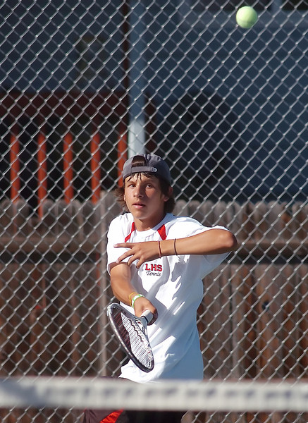 Loveland High School's Joe Diaz returns a shot during his No. 1 singles match against Thompson Valley's Kaleb Harmon on Thursday, Sept. 2, 2010 at TVHS.