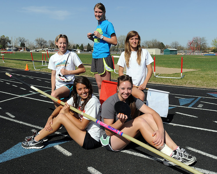 Members of the Loveland High School track team pose for a photo Monday afternoon. Clockwise from bottom left are Lisa Bohannon, Torrey Stephenson, Stefanie Tuder, Ashley Krawczuk and Lorell Stuht.