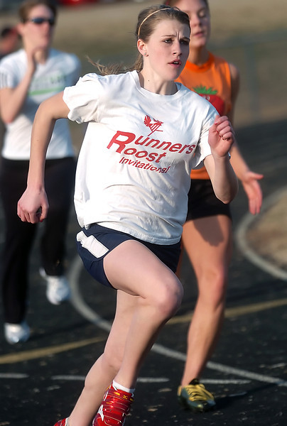 Loveland High School junior Stephanie Hutsell works on a drill with teammates during track practice Thursday afternoon at the school in preparation for the upcoming season.