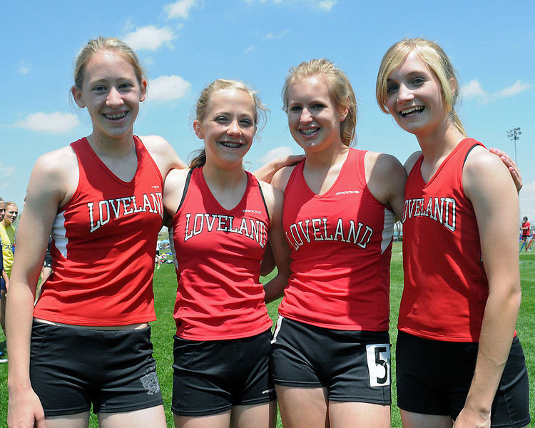 Members of Loveland High School's 3200-meter relay team pose after placing second in the race Thursday, May 20, 2010 during the Class 5A State Track and Field Championships at Jeffco Stadium in Lakewood. From left to right are Torrey Stephenson, Kailie Hartman, Chelsea Glanzer and Kailey Fuchs.