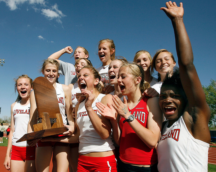 Members of Loveland High School's girls track team cheer after receiving their trophy for taking first as a team at the Class 5A State Track and Field Championships on Saturday at Jeffco Stadium in Lakewood.