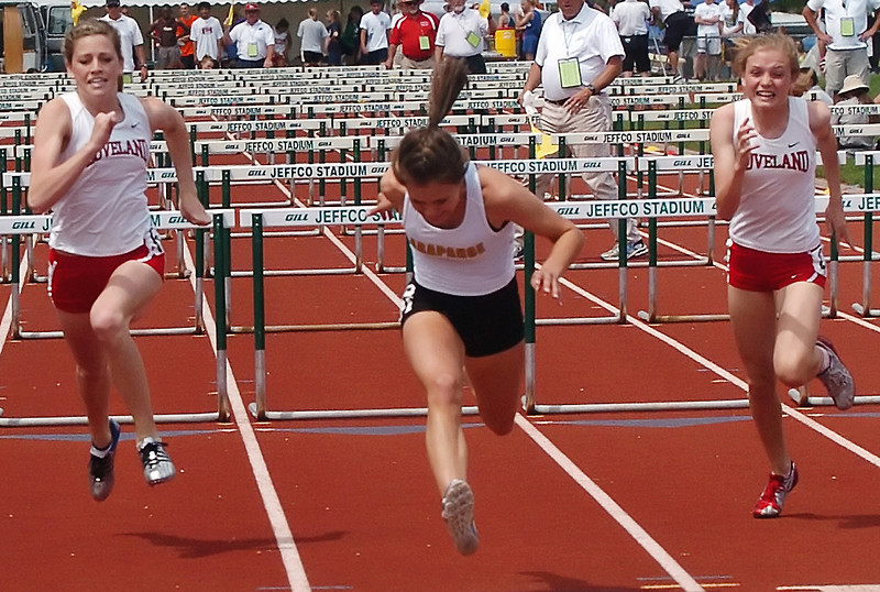 Loveland High School's Maggie Andersen, left, and Kaylee Packham, right, sprint for the finish line while competing in the 100-meter hurdles during the Class 5A State Track and Field Championships on Friday, May 21, 2010 at Jeffco Stadium in Lakewood.