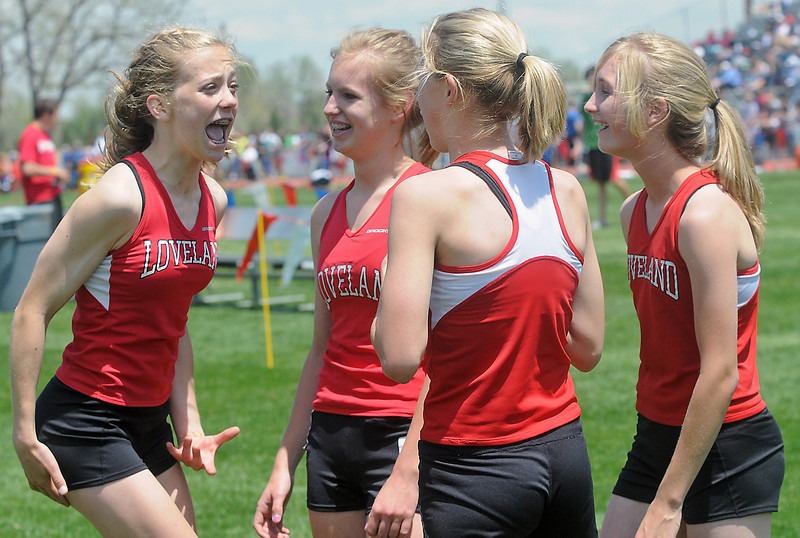 Members of Loveland High School's 3200-meter relay team, from left, Kailie Hartman, Chelsea Glanzer, Torrey Stephenson and Kailey Fuchs are all smiles at the conclusion of their race Thursday during the Class 5A State Track and Field Championships at Jeffco Stadium in Lakewood.