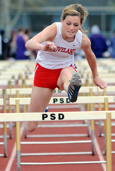 Loveland High School junior Maggie Andersen clears the final hurdle during a heat of the 100-meter hurdles Thursday at the Front Range League Championships at Rocky Mountain High School's French Field in Fort Collins.