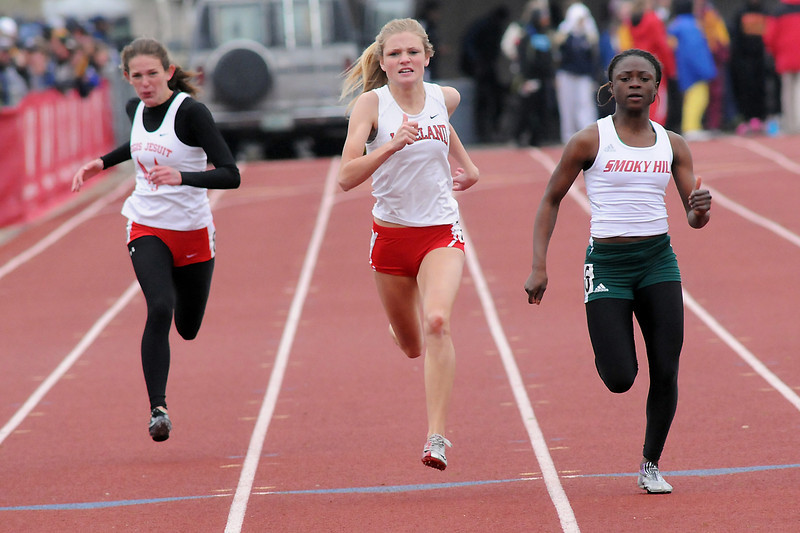Loveland High School's Kaylee Packham, center, sprints down the track while competing in a preliminary heat of the 200-meter dash during the Class 5A State Track and Field Championships on Thursday, May 19, 2011 at Jeffco Stadium in Lakewood, Colo.