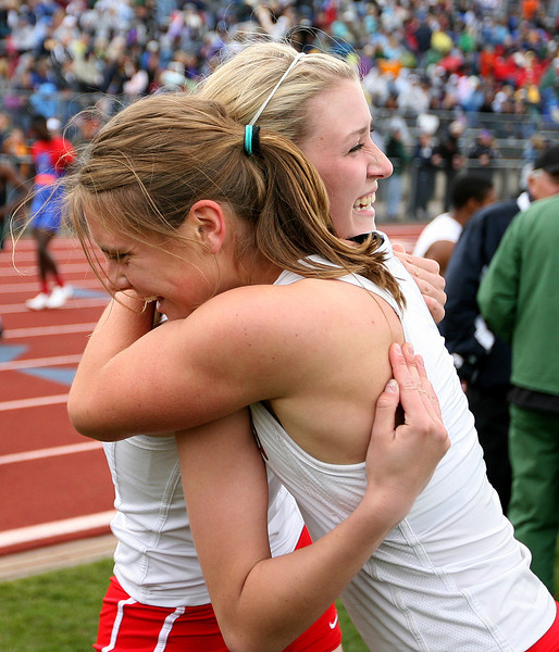 Loveland hugs each other after winning first place during State Track on Friday at Jefferson County Stadium in Denver. (Photo by Gabriel Christus)