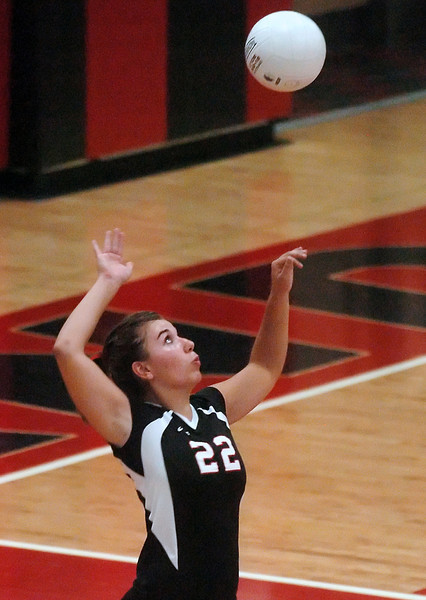 Loveland High School senior Shana McGownd hits a serve during a match against Berthoud on Thursday, Sept. 9, 2010 at LHS. The Indians won, 3-0.