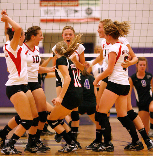 The Loveland High School volleyball team celebrate after scoring a point against Mountain View on Monday at Mountain View High School. Photo by Gabriel Christus