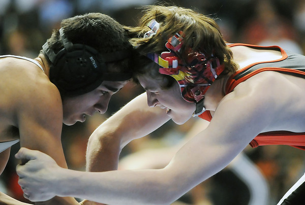 Loveland High School senior Chance Leingang, right, squares off against Central Grand Junction's Jaqub Gurule in their 119-pound match during the State Wrestling Championships on Thursday, Feb. 18, 2010 at the Pepsi Center in Denver.