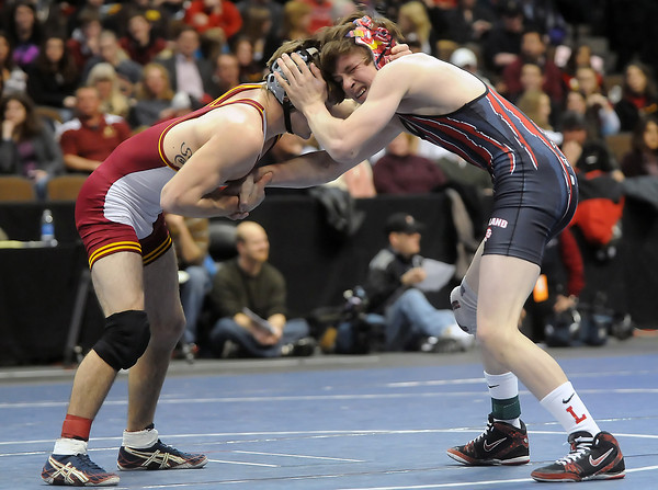 Loveland High School senior Chance Leingang against Rocky Mountain's Jeremy Schmitt in the Class 5A 119-pound final match of the State Wrestling Championships on Saturday at the Pepsi Center in Denver. Lenigang lost, 5-0.