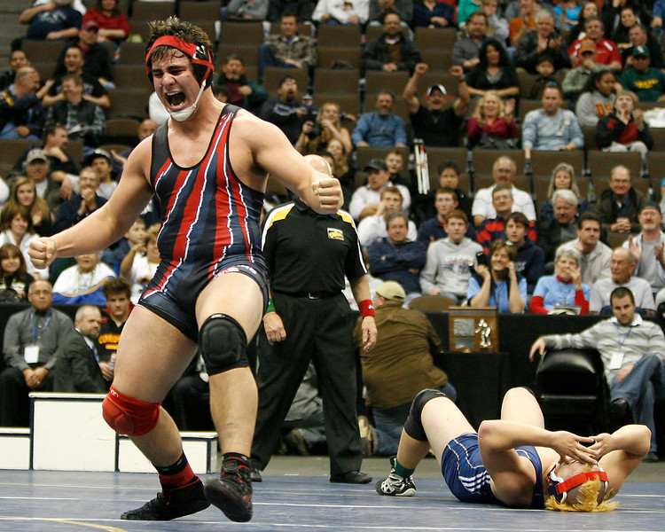 Loveland High School senior Connor Medbery celebrates after pinning Heritage High School senior Jeremy Todd in the 5A 285 lb. Colorado State Wrestling finals Saturday at the Pepsi Center in Denver. (Photo by Gabriel Christus)