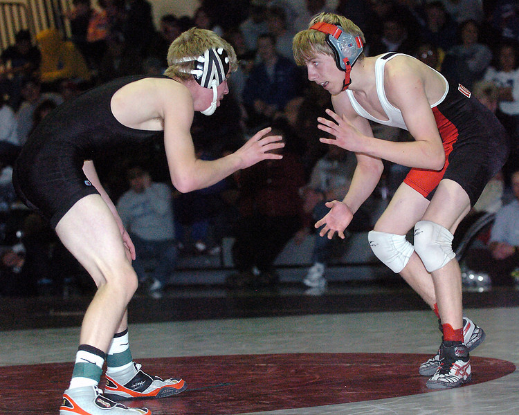 Loveland High School sophomore Jordan Hendrickson, right, squares off against Roosevelt's Presley Papachek during the 130-pound finals of the Roosevelt Invitational on Saturday, Jan. 2, 2010 at Roosevelt High School in Johnstown. Hendrickson won, 7-4.