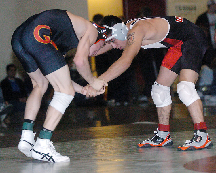 Loveland High School's Garrett Vasquez, right, wrestles Castle View's Colby Lindfield during the 135-pound finals match for the Roosevelt Invitational on Saturday, Jan. 2, 2010 at Roosevelt High School in Johnstown.