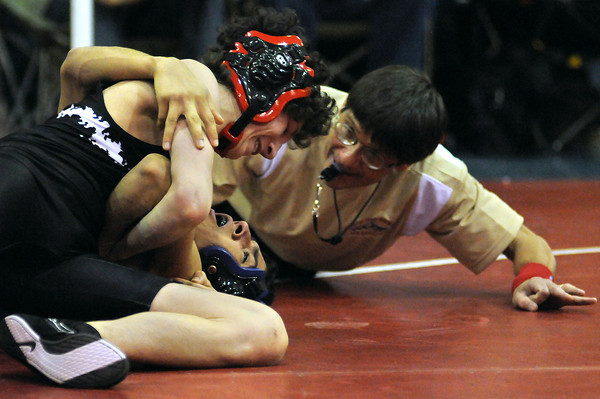 Roosevelt High School's Jace lopez, top, pins Anthony Deleon of Fort Lupton High School during the 103-pound, semi-final bout of the Top of the Rockies Wrestling Tournament on Saturday at Centaurus High School in Lafayette.