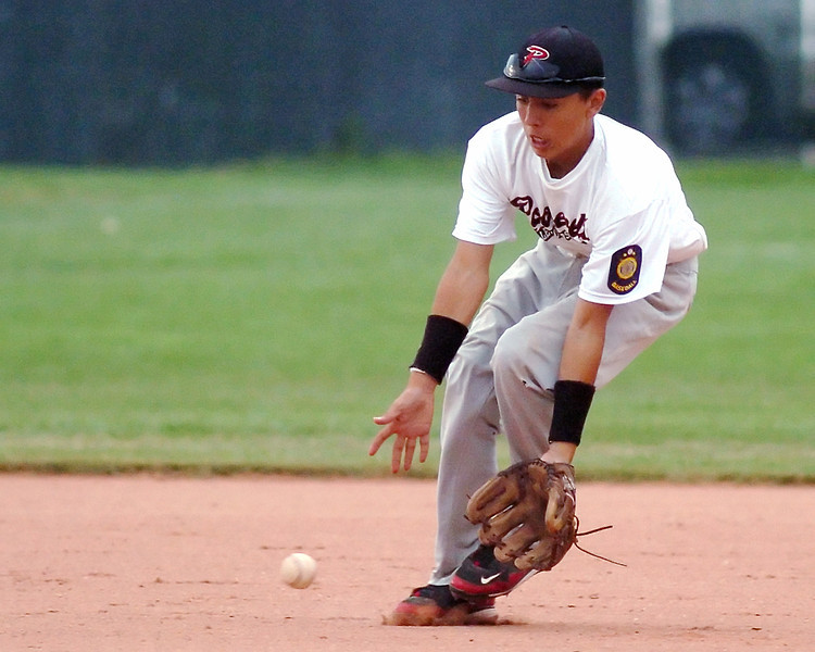 Roosevelt High School shortstop Ray Hernandez scoops up a ground ball in the bottom of the fifth inning of a game against Eaton on Tuesday, July 20, 2010 at Eaton. Roosevelt lost, 8-4.