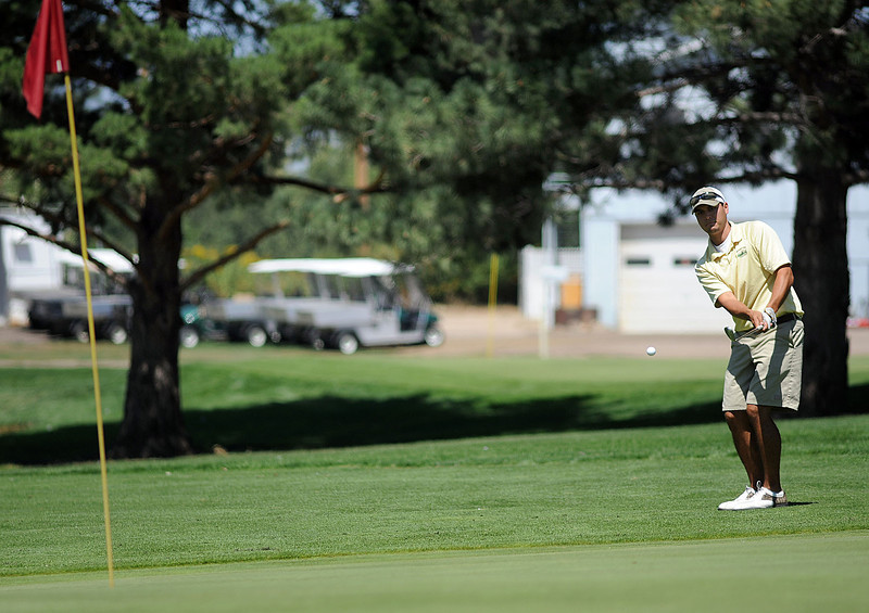 Dano Aldaz chips onto the 10th green on Sunday during the Loveland Men's City Championship at the Olde Course at Loveland. Aldaz shot 149 during the two day tournament.