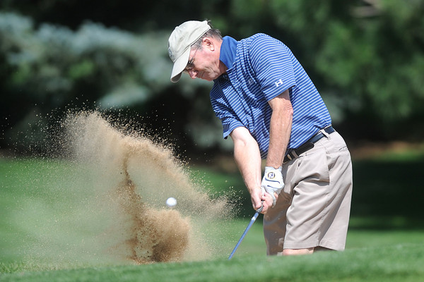 Mark Hailey blasts out of a sand trap on No. 17 while competing in the Loveland City Championship on Saturday, Aug. 18, 2012 at Mariana Butte Golf Course.