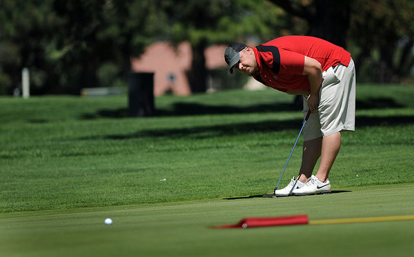 Casey Brock reacts to missing a putt on the 10th green on Sunday during the Loveland Men's City Championship at the Olde Course at Loveland. After leading with a 70 after the first day of the tournament, Brock finished with a combined total of 145 and a 3rd place finish.