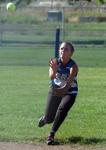 Loveland Rage 16A right fielder Kendall Johnson eyes a fly ball before catching it for an out in the top of the second inning of a game against the Northern Colorado Roadrunners on Friday at the Barnes Softball Complex. The Rage won, 4-2.