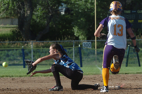 Loveland Rage 16A first baseman Chanley Burge completes a double play during a game against the Northern Colorado Roadrunners on Friday at the Barnes Softball Complex. The Rage won, 4-2.