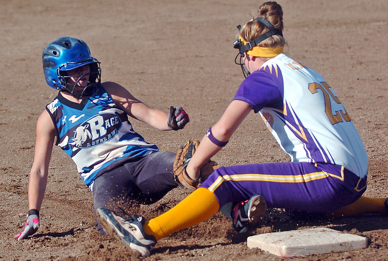 Colissa Bakovich of the Loveland Rage 16A team slides safely into third base during a game against the Northern Colorado Roadrunners on Friday at the Barnes Softball Complex. The Rage won, 4-2.