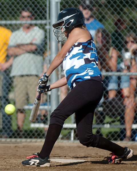 Loveland Rage 16A player Chanley Burge hits a single in the bottom of the second inning of a game against the Northern Colorado Roadrunners on Friday at the Barnes Softball Complex. The Rage won, 4-2.