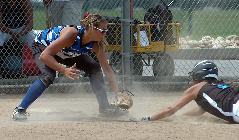Colorado Rage 337 tags out Chaos #5 at third base during their game Sunday.