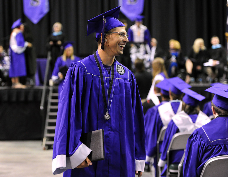 Colton Pitoniak, a Mountain View graduate, is all smiles after receiving his diploma at the Budwieser Events Center at The Ranch in Loveland on Saturday, May 25, 2013.