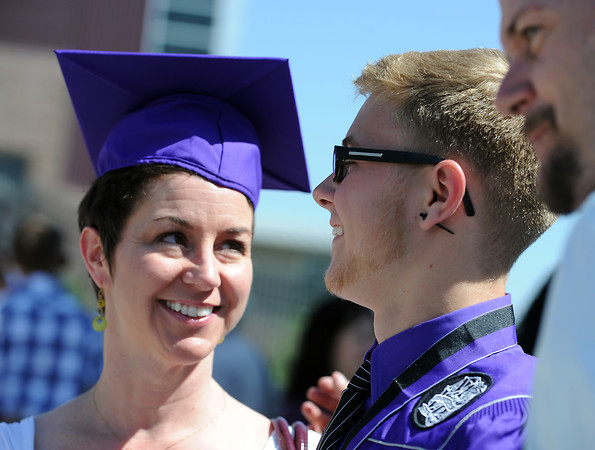 Mountain View graduate Alec Heier smiles at his mom after putting his cap on her after his graduation ceremony at the Budwieser Events Center at The Ranch in Loveland on Saturday, May 25, 2013.