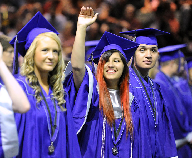 Graduate Charlee Maestas waves to family and friends during Mountain View's graduation ceremony at the Budwieser Events Center at The Ranch in Loveland on Saturday, May 25, 2013.