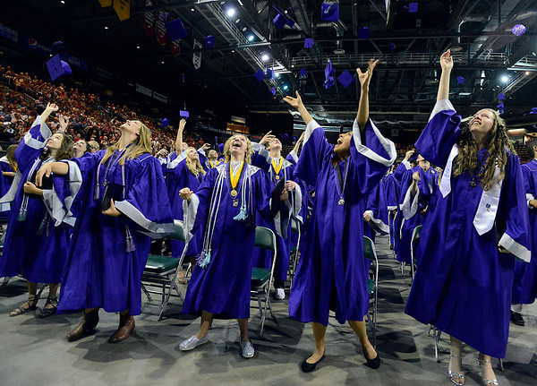 Mountain View High School graduates toss their caps in the air during their commencement ceremony at the Budwieser Events Center at The Ranch in Loveland on Saturday, May 25, 2013.