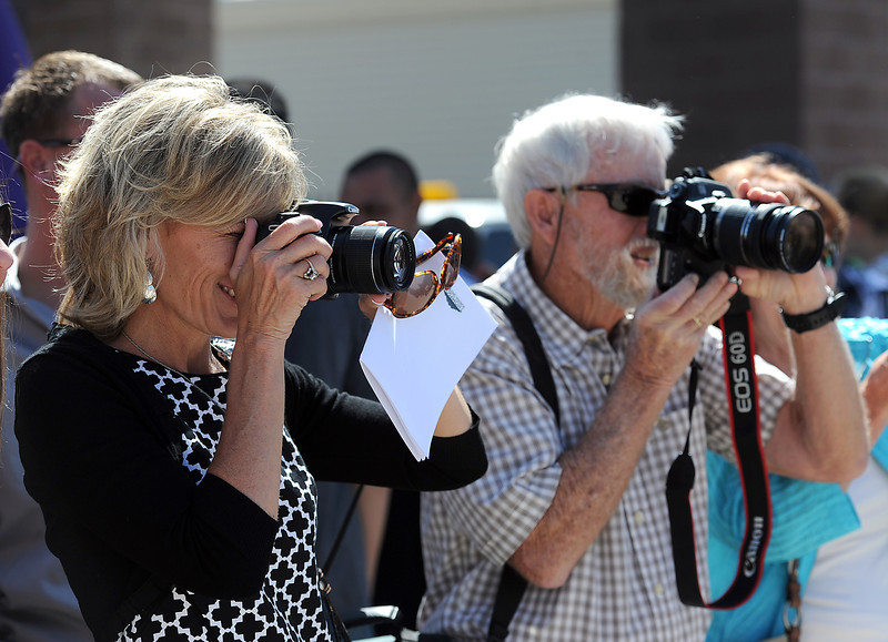 Michelle Logan, left, and her dad Al Zeigler, take photos of Logan's son, Mountain View graduate Connor Logan after his graduation ceremony at the Budwieser Events Center at The Ranch in Loveland on Saturday, May 25, 2013.