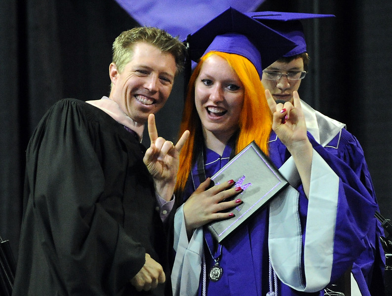 Mountain View High School graduate Alexis Welch flash a sign to the audience after she received her diploma during graduation at the Budwieser Events Center at The Ranch in Loveland on Saturday, May 25, 2013.