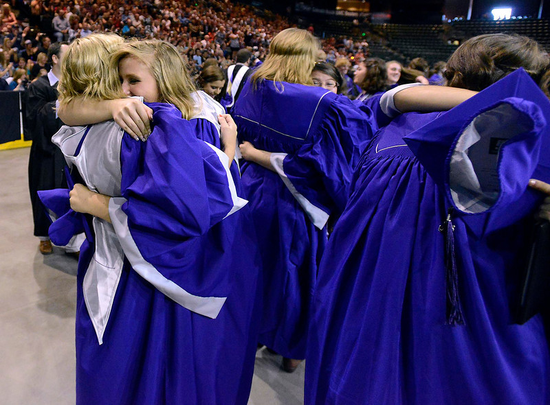 Mountain View graduates Rachel Ahlquist and Delaney Schoolmeester hug after throwing their caps in the air during their graduation ceremony at the Budwieser Events Center at The Ranch in Loveland on Saturday, May 25, 2013.
